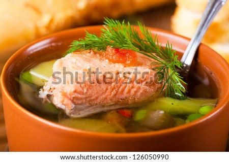 Fish a trout soup and bread with fennel