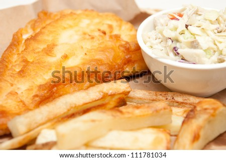 fish and chips, a classic diner meal. This fresh haddock fillet is coated with batter and deep fried with home made french fries and coleslaw