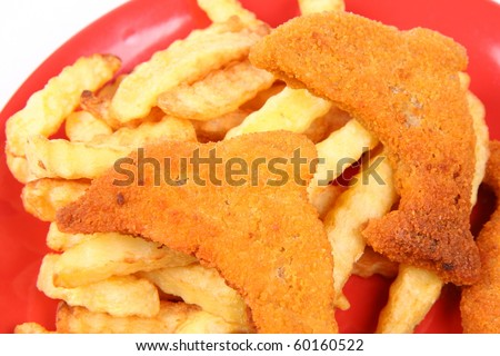 Fish and chips - dolphin shaped fish fingers for kids - in close up