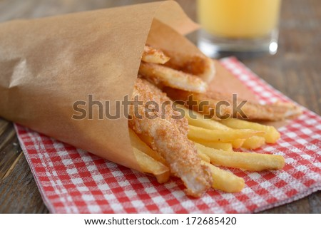 Fish and chips in a paper bag - stock photo