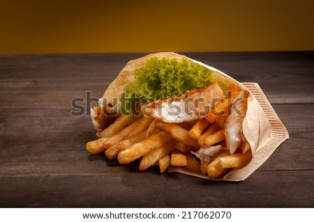 fish and chips in paper bag - stock photo
