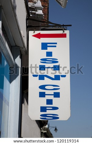 Fish and Chips Sign against Blue Sky Background