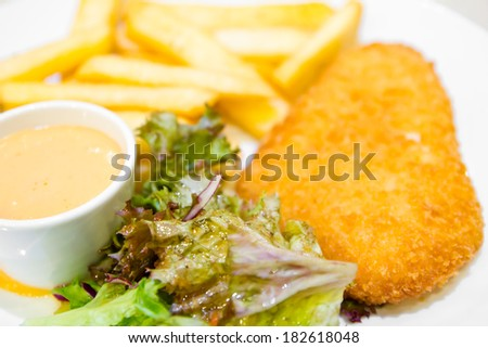 Fish and chips with dip sauce - stock photo