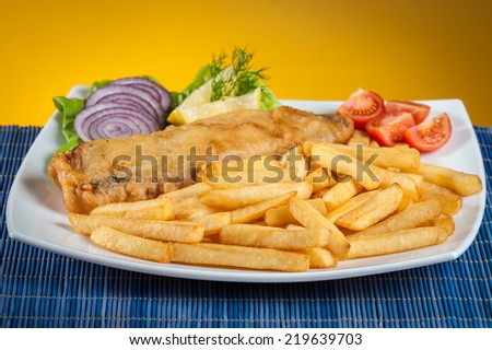 fish and chips with lettuce and tomato