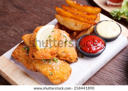 Fish and chips with potato wedge - stock photo
