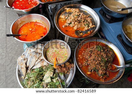 Fish and curry in Thailand - stock photo