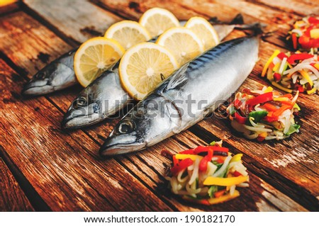 Fish arranged with mixed vegetables - stock photo