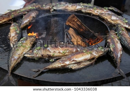 fish barbecue. baked fish on the grill fish on fire