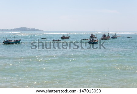 Fish boats on Indian Ocean, southern coast of Sri Lanka.