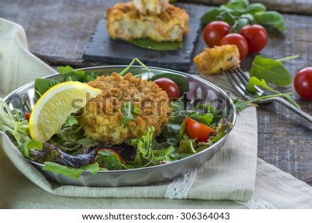 Fish cakes with fresh rocket salad