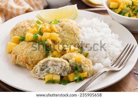 fish cakes with mango salsa and rice, close-up, horizontal - stock photo
