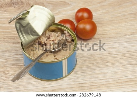 Fish - canned tuna in olive oil, healthy meals with vegetables, bank of canned tuna fish with blue label - stock photo