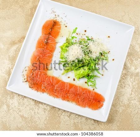 Fish Carpaccio with salad and mozzarella - stock photo