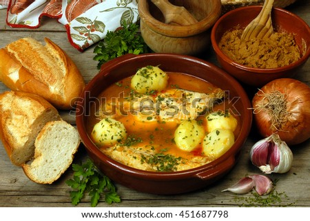 Fish casserole and Escaldon de Gofio , typical food of Tenerife, Canary Islands - stock photo