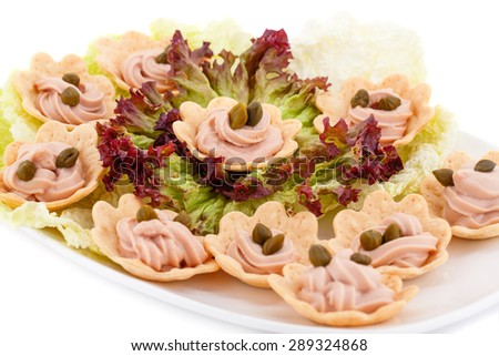 Fish cream and  capers in pastries, lettuce on plate. - stock photo