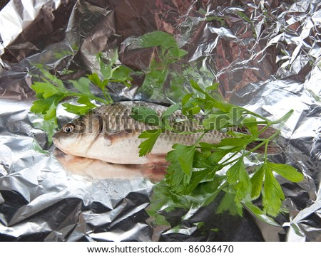 Fish crucian prepared for baked in foil