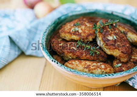 fish cutlets countrylike in rustic ceramic plate - stock photo
