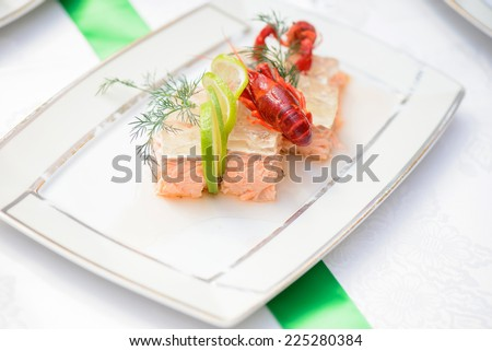 Fish dish and crayfish on the festive table - stock photo