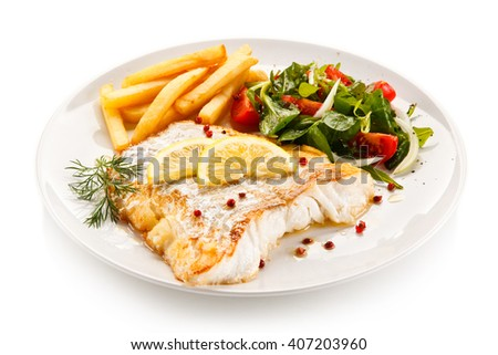 Fish dish - fried fish fillet and vegetables  - stock photo