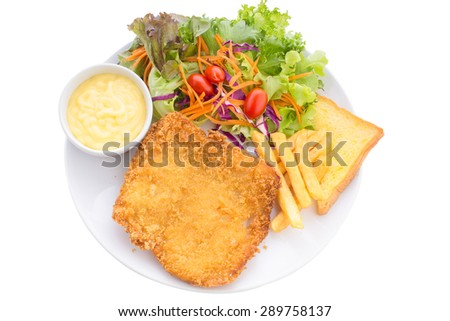 Fish dish - fried fish fillet with French fries and vegetables isolate on white background