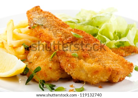 Fish dish - fried fish fillet with vegetables on white background - stock photo