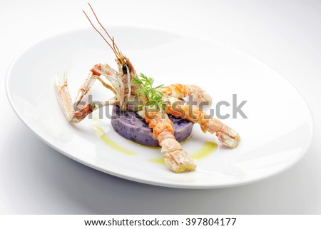 fish dish Pie purple potatoes with prawns baked