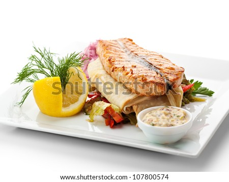 Fish Dishes - Salmon Steak with Vegetables, Lavash and Tartar Sauce - stock photo