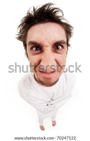 Fish eye shot of screaming insane man in strait-jacket on grey background - stock photo