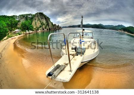 Fish-eye view of boat in the Russian Primorye Spokoynaya bay HDR image  - stock photo