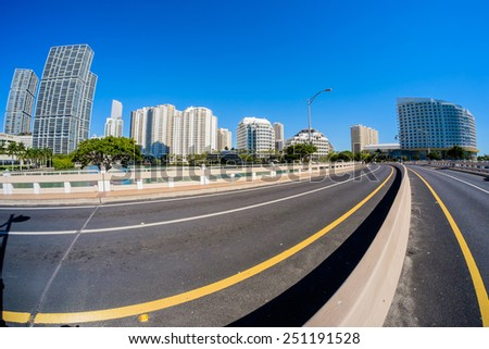 Fish eye view of the bridge road leading to Brickell Key in downtown Miami. - stock photo