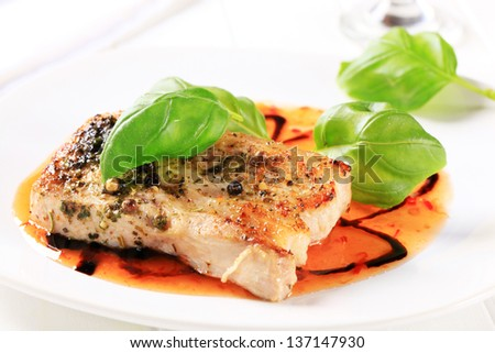 fish fillet breaded in herbs and spice - stock photo