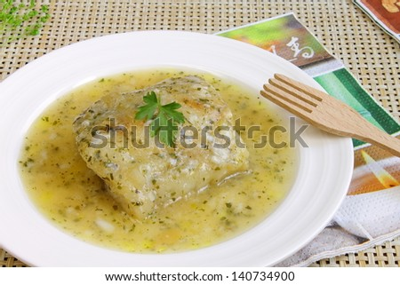 Fish fillet in a green sauce