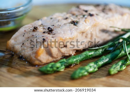 Fish fillet, salmon steak with artichoke, spice and olive oil for healthy tasty lunch or dinner - stock photo