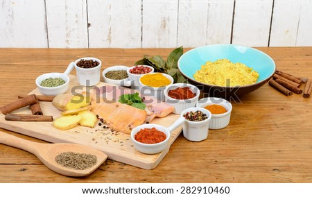 fish fillet with assortment of spices - stock photo