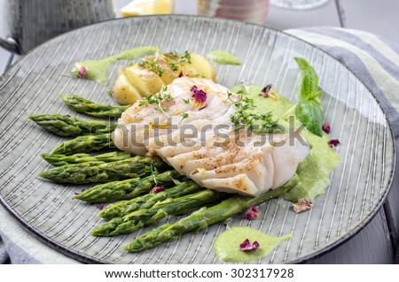 fish fillet with green asparagus - stock photo