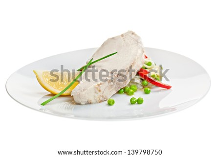 fish fillet with lemon and garnish