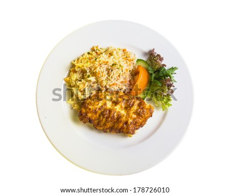 fish fillet with mayonnaise and garnished with rice - stock photo