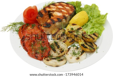 Fish fillet with tomato sauce, onions and potatoes