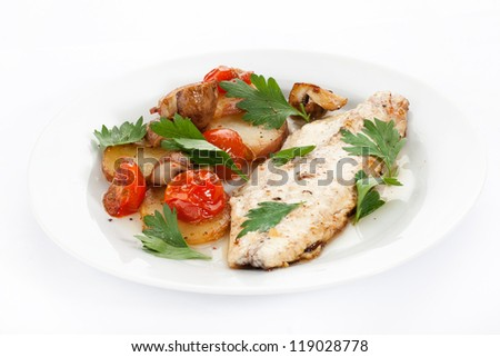 fish fillet with vegetables on a plate - stock photo