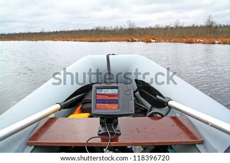 Fish-finding fathometer on rubber boat - stock photo