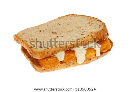 Fish finger sandwich made with multi grain brown bread with tartar sauce isolated against white - stock photo
