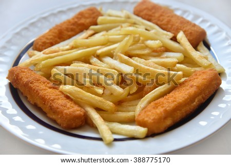 Fish fingers and chips on the plate. Selective focus. - stock photo