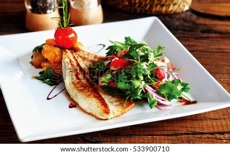 Fish grill and salad. Prepared with a special presentation, diet meal.
