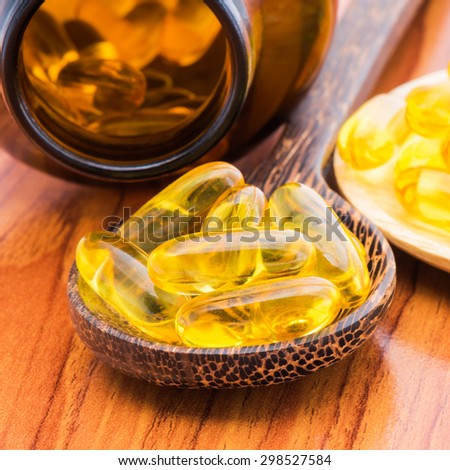 Fish oil capsule - stock photo