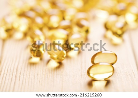 Fish oil capsule isolated on white - stock photo