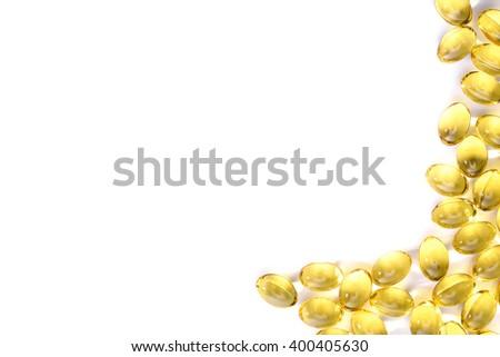 Fish oil capsule, Omega 3-6-9 fish oil yellow soft gels capsules, Sacha inchi oil, Yellow oil pills on white background - stock photo