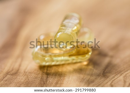 Fish oil capsules in a spoon. vitamin D , dietary supplement - stock photo