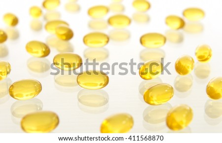 Fish oil capsules on white background. Health care concept. - stock photo