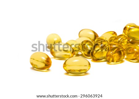 Fish oil supplement capsules isolated on white background - stock photo