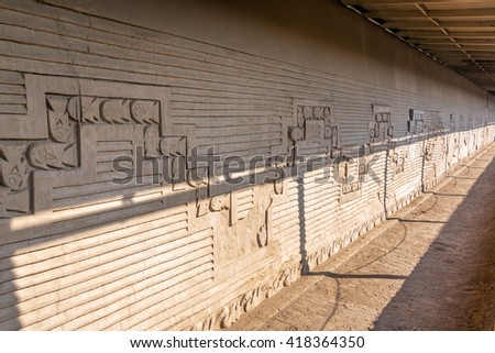 Fish on a wall in the ruins of Chan Chan located in Trujillo, Peru - stock photo